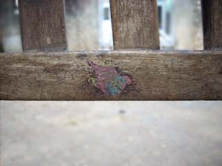 Stickers on wooden chair.